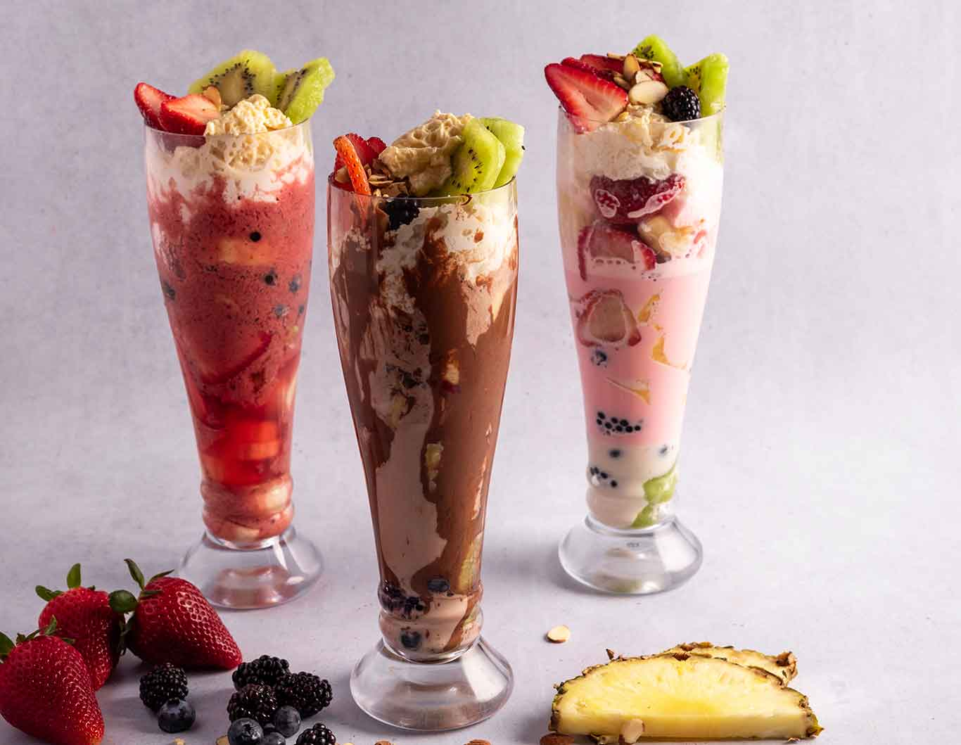 Three flavors of chocolate and fruit smoothies